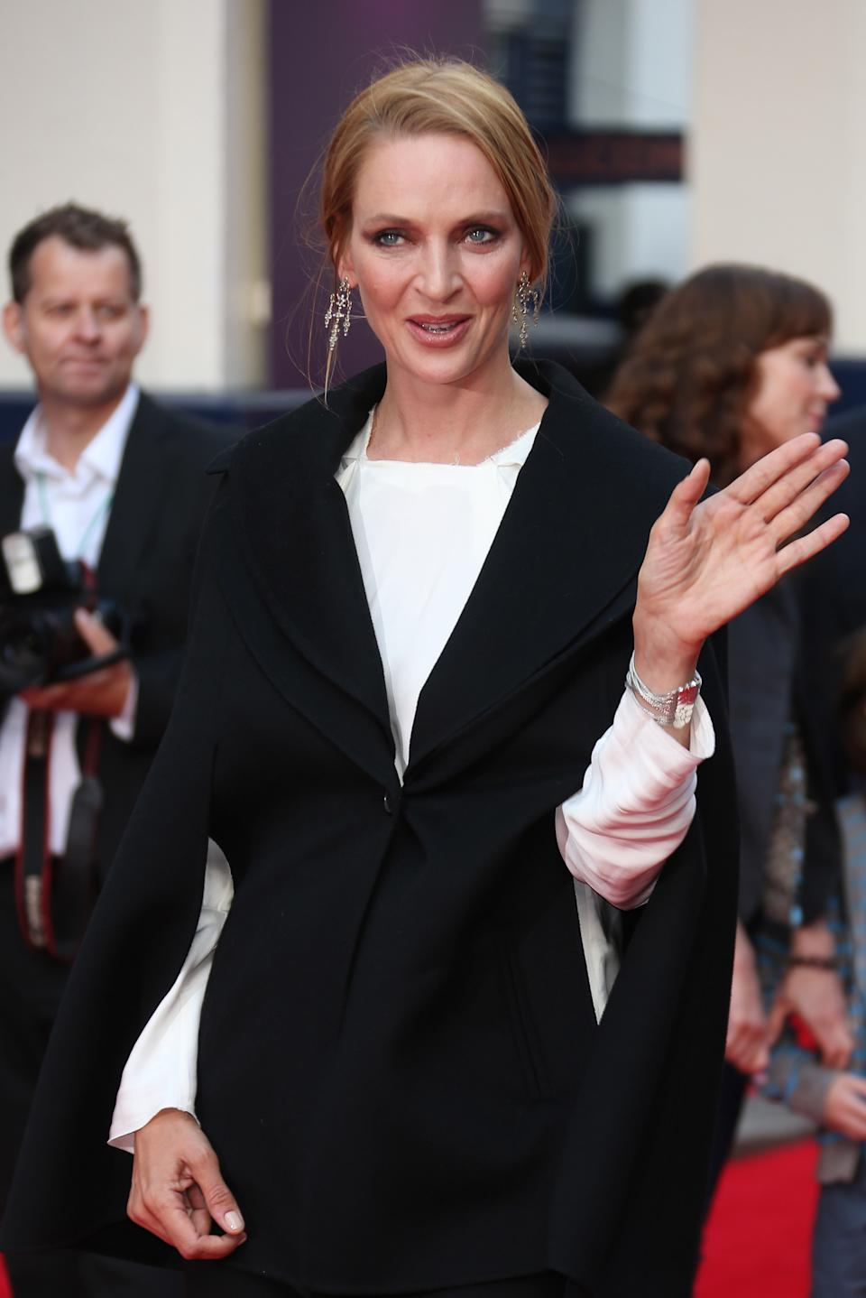 Uma Thurman gestures, as she arrives for the opening night of Charlie and the Chocolate Factory, a new stage musical based on Roald Dahl's popular story about Willy Wonka and his amazing Chocolate Factory, at the Drury Lane Theatre in central London, Tuesday, June 25, 2013. (Photo by Joel Ryan/Invision/AP)