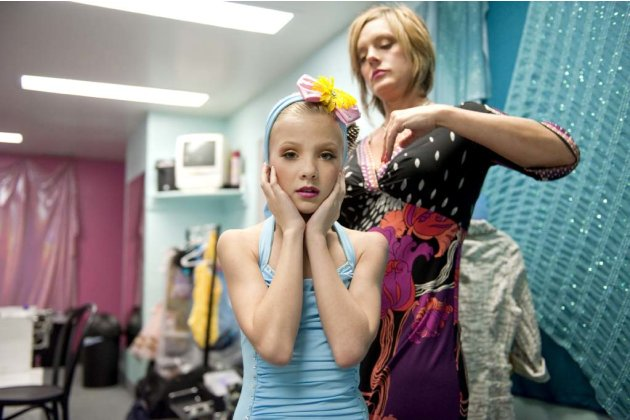 "Kelly preps her daughter Paige's hair for the competition in ""Dance Moms."""