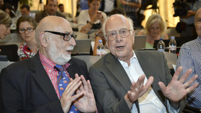FILE - In this Wednesday, July 4, 2012 file photo Belgian physicist Francois Englert, left, and British physicist Peter Higgs right, answer journalist's question about the scientific seminar to deliver the latest update in the search for the Higgs boson at the European Organization for Nuclear Research (CERN) in Meyrin near Geneva, Switzerland. Francois Englert and Peter Higgs were awarded the Nobel physics prize on Tuesday Oct. 8, 2013. (AP Photo/Keystone/Martial Trezzini, File)