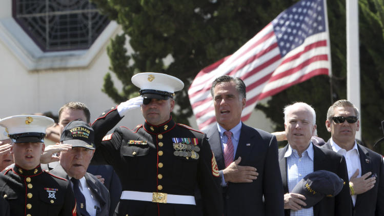 Republican presidential candidate, former Massachusetts Gov. Mitt Romney, center, stands with Sen. John McCain, R-Ariz., second from right and San Diego Veteran of the year Marine David Dicky while during a campaign stop at the Veterans Museum & Memorial Center, Monday, May 28, 2012, in San Diego.  (AP Photo/Mary Altaffer)