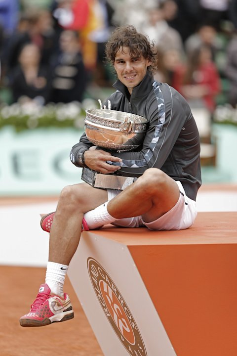 Rafael Nadal of Spain poses with the trophy after winning the mens final match against Novak Djokovic of Serbia at the French Open tennis tournament in Roland Garros stadium in Paris, Monday June 11,