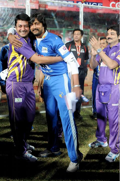 Karnataka Bulldozers skipper Sudeep and Bengal Tigers skipper Jisshu Sengupta during a Celebrity Cricket League match between Bengal Tigers and Karnataka Bulldozers at Chinnaswamy Stadium in Bangalore