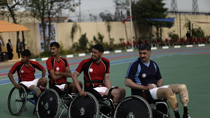 Disabled Pakistani soldiers watch other soldiers competing in archery during a sports competition in Rawalpindi, Pakistan, Saturday, March 16, 2013. Dozens of wounded Pakistani troops, many of them maimed during the fighting in the country's tribal areas bordering Afghanistan, gathered Saturday for a sports competition designed to help them recover -- in body and spirit. (AP Photo/Muhammed Muheisen)
