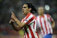 Atletico Madrid's Colombian forward Radamel Falcao celebrates after scoring a goal during the UEFA Europa League final football match between Atletico Madrid and Athletic Bilbao at the National Arena stadium in Bucharest. A double by Falcao inspired Atletico Madrid to a 3-0 win and their second Europa League trophy in three seasons