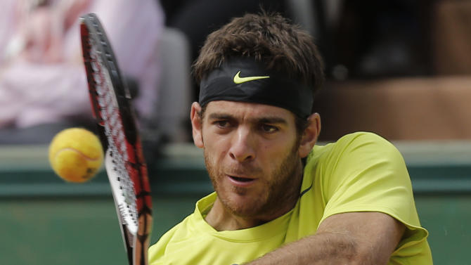 Juan Martin del Potro of Argentina returns in his quarter final match against Roger Federer of Switzerland at the French Open tennis tournament in Roland Garros stadium in Paris, Tuesday June 5, 2012. (AP Photo/Christophe Ena)
