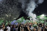Greek Socialist party supporters wave flags during party leader Evangelos Venizelos&#39; address in front of the Greek Parliament at Syntagma square in Athens on May 4. Not only Greece but also Europe braced for an election that polls indicate will fail to produce a clear winner, and which markets worry will plunge the eurozone into fresh turmoil