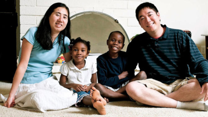This undated photo provided by the David House Agency shows Matthew, right, and Grace Huang, left, with two of their adopted children, Gloria, center left, and one of their two sons. The couple has been jailed in Qatar on a charge of murder with intent and is accused of starving Gloria, 8, to death, according to a coalition of legal and public relations groups that are working on the case from the U.S. and trying to draw publicity to what they claim is are unjust arrests. (AP Photo/David House Agency)