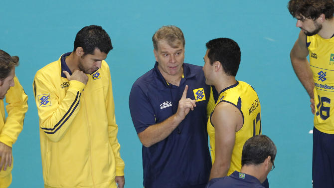 Brazilian head coach Bernardo Rezende, center, gives instructios to Marlon Muraguti Yared, second from right, and other members during their match against Iran in the fourth round of the men's World Cup volleyball tournament in Tokyo, Friday, Dec. 2, 2011.  (AP Photo/Koji Sasahara)