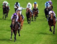 Horse &#39;Camelot&#39; (L), ridden by Joseph O&#39;Brien, heads the field to win the Derby race on Derby Day, at Epsom in Surrey, southern England, on June 2. Camelot&#39;s greatness as a racehorse is not in doubt but on Saturday he can achieve legendary status by winning the English St Leger and become the first horse to win the Triple Crown in 42 years