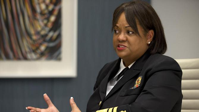 """In this Dec. 5, 2012, photo, Regina Benjamin, Surgeon General of the United States, is interviewed after speaking about health disparities in Washington. African-American women have the highest rate of obesity of any group of Americans. Four out of five black women have a body mass index above 25 percent, the threshold for being overweight or obese, according to the Centers for Disease Control and Prevention. By comparison, nearly two-thirds of all Americans are in this category, the CDC said. While first lady Michelle Obama has succeeded at encouraging exercise through her """"Let's Move!"""" campaign, the spark for this current activity among black women most likely was lit last year when Surgeon General Regina Benjamin observed publicly that women must stop allowing concern about their hair prevent them from exercising. (AP Photo/Jacquelyn Martin)"""