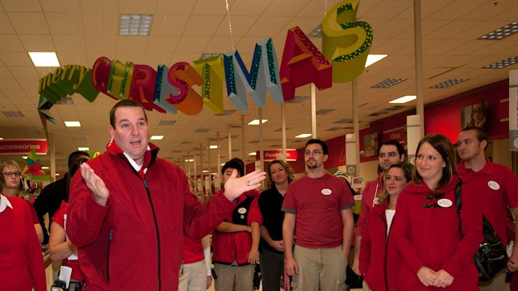 Bryan Everett, Senior Vice President , Target, helps the team at the Roseville, Minn. Target store prepare on Thursday Nov. 22, 2012, for Black Friday shoppers. (Dawn Villella/AP Images for Target)