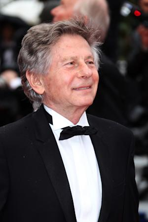 "FILE - In a Monday, May 21, 2012 file photo, director Roman Polanski arrives for the screening of ""You Ain't Seen Nothing Yet"" at the 65th international film festival, in Cannes. Samantha Geimer, the former teen whom Roman Polanski was convicted of having sex with in 1977, leading to one of Hollywood's most notorious scandals and the director's flight from the U.S., is writing a memoir. Geimer, now 47, has a deal with Atria Books for ""The Girl: Emerging from the Shadow of Roman Polanski."" Atria, a Simon & Schuster imprint, announced Tuesday, Oct. 9, 2012 that the book will come out next fall. (AP Photo/Joel Ryan, File)"