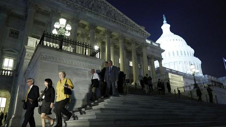 Members of the U.S. House of Representatives depart after a late-night vote on fiscal legislation to end the government shutdown, at the U.S. Capitol in Washington, October 16, 2013. REUTERS/Jonathan Ernst