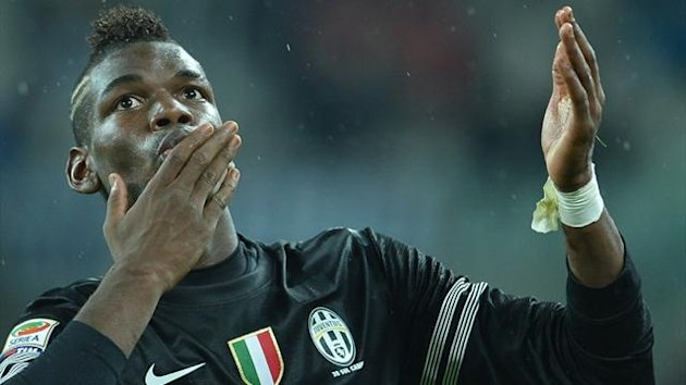 Juventus midfielder Paul Pogba celebrates after scoring against Bologna in Serie A (AFP)