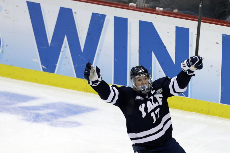 Yale's Andrew Miller (17) celebrates his breakaway goal in the third period of the NCAA men's college hockey national championship game in Pittsburgh, Saturday, April 13, 2013. Yale defeated Quinnipiac 4-0.  (AP Photo/Gene J. Puskar)