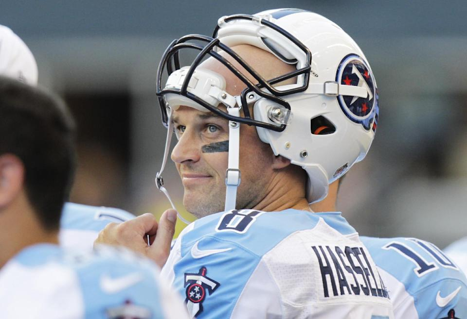 Tennessee Titans quarterback Matt Hasselbeck stands on the sideline after he threw an interception that was returned for a touchdown by the Seattle Seahawks in the first half of an NFL football preseason game, Saturday, Aug. 11, 2012, in Seattle. (AP Photo/Rick Bowmer)