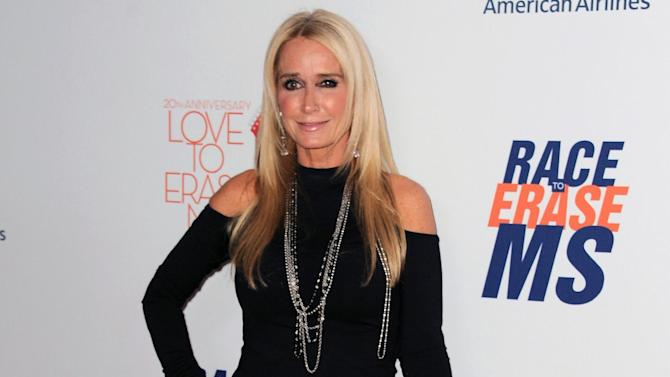 FILE - In this May 3, 2013 file photo, Kim Richards arrives at the 20th annual Race to Erase MS event in Los Angeles. Richards is out on bail after she was arrested on suspicion of shoplifting in Los Angeles. The 50-year-old reality TV star was jailed Sunday, Aug. 2, 2015,  after being accused of taking about $600 in merchandise from a Target store in the Van Nuys area. (Photo by Jordan Strauss/Invision/AP, File)
