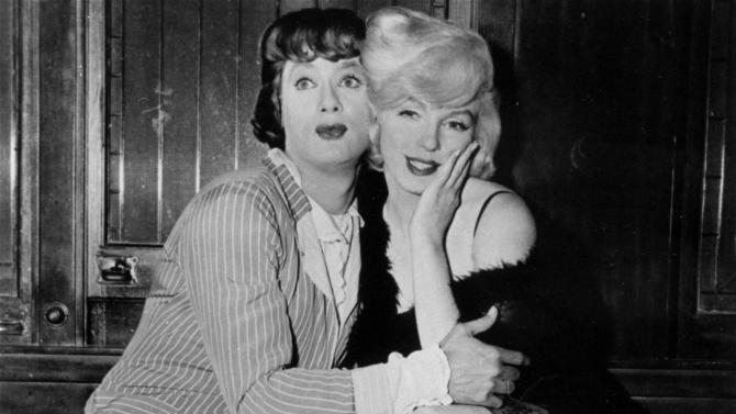 "FILE - In this 1959 file photo provided by United Artists, Tony Curtis, left, and Marilyn Monroe are shown in the hilarious, milestone comedy, ""Some Like It Hot,"" produced, directed, and co-scripted by Billy Wilder. (AP Photo, File)"