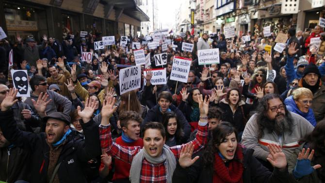 Demonstrators shout during a protest against the Spanish government's new anti-protest law in Madrid