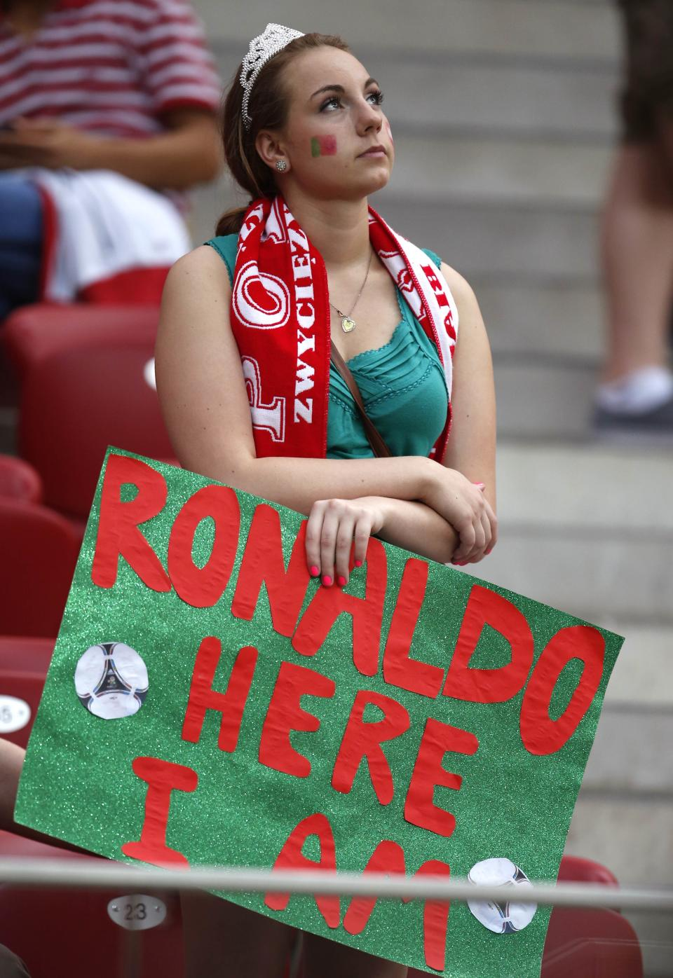 A Portugal fan waits for the start of the Euro 2012 soccer championship quarterfinal match between Czech Republic and Portugal in Warsaw, Poland, Thursday, June 21, 2012. (AP Photo/Armando Franca)