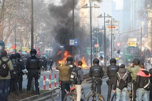 Riot police use water cannon during clashes with protesters…