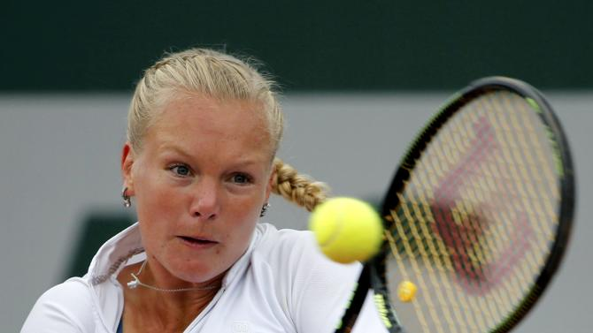 Kiki Bertens of the Netherlands plays a shot to Svetlana Kuznetsova of Russia during their women's singles match at the French Open tennis tournament at the Roland Garros stadium in Paris