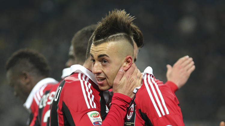 AC Milan forward Stephan El Shaarawy, right, celebrates with his teammate Antonio Nocerino after scoring during the Serie A soccer match between Inter Milan and AC Milan at the San Siro stadium in Milan, Italy, Sunday, Feb. 24, 2013. (AP Photo/Antonio Calanni)