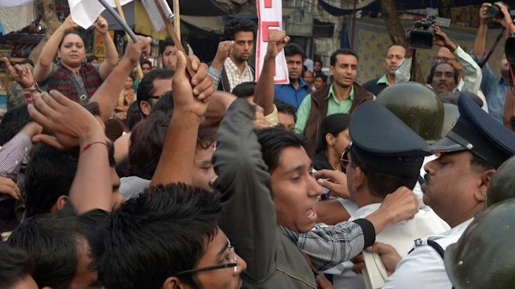 Indian protesters push police barricades as they shout anti-US slogans near the United States Information Service (USIS) in Kolkata on December 19, 2013