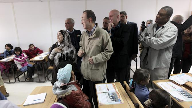 "The United Nations Secretary-General Ban Ki-moon speaks to Syrian refugee children inside a classroom at Zaatari refugee camp, in Mafraq, Jordan, near the Syrian border, Saturday, Dec. 7, 2012. U.N. Secretary-General Ban Ki-Moon on Friday called on the Syrian government to ""stop the violence in the name of humanity"", during a visit to the Zaatari refugee camp in Jordan, close to the Syrian border. (AP Photo/Mohammad Hannon)"