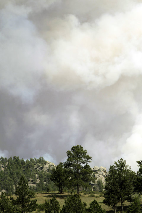Smoke rises from the High Park Fire east of Red Feather Lakes, Colo., on Sunday, June 17, 2012, as the wildfire continues to burn in northern Colorado. Strong winds are fanning the blaze that has dest