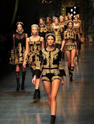 Models display creations as part of Dolce & Gabbana Fall-winter 2012-2013 show