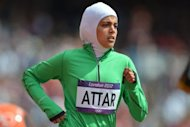 Saudi Arabia's Sarah Attar competes in the women's 800m heats at the athletics event of the London 2012 Olympic Games. Attar made history, becoming the first female athlete to represent Saudi Arabia in Olympics track and field -- but limped home a distant last in her heat