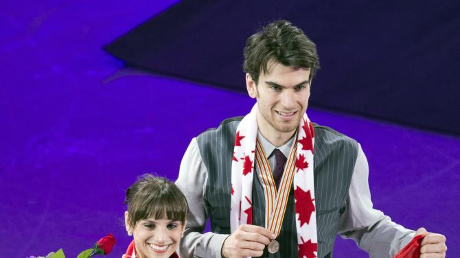Meagan Duhamel and Eric Radford of Canada pose with their bronze medals after placing third in the pairs competition at the World Figure Skating Championships Friday, March 15, 2013 in London, Ontario. (AP Photo/The Canadian Press, Frank Gunn