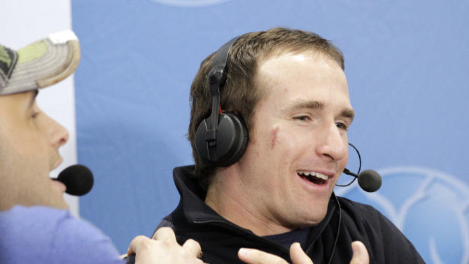 New Orleans Saints quarterback Drew Brees, right, reacts as Craig Carton, left, grabs him during an interview on radio row at the Super Bowl XLVI media center Thursday, Feb. 2, 2012, in Indianapolis. The New England Patriots will face the New York Giants in Super Bowl XLVI Feb. 5. (AP Photo/David J. Phillip)