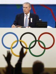 Jacques Rogge, president of the International Olympic Committee (IOC), watch IOC members vote at a report session during the 125th IOC session in Buenos Aires, Argentina, Monday, Sept. 9, 2013. (AP Photo/Victor R. Caivano)