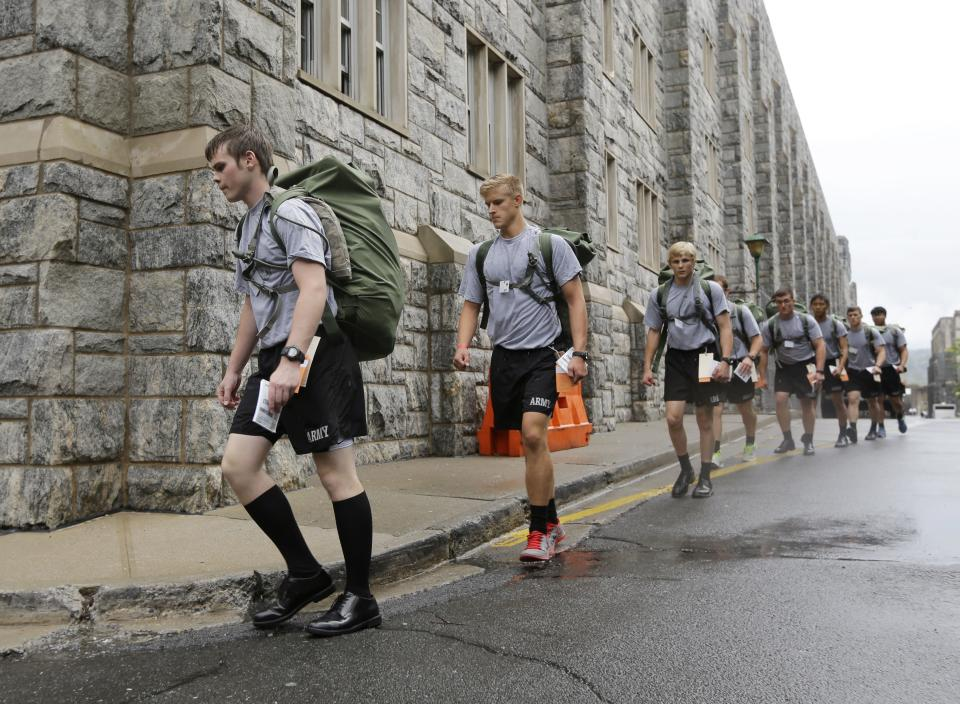 New cadet Cole Ogrydziak, 18, marches with other cadets during Reception Day at the U.S. Military Academy at West Point on Monday, July 1, 2013, in West Point, N.Y. He is entering the academy with his twin brother Sumner, and brother Noah, 19. (AP Photo/Mike Groll)