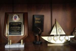 A mini sculpture in the shape of the Bible is displayed …