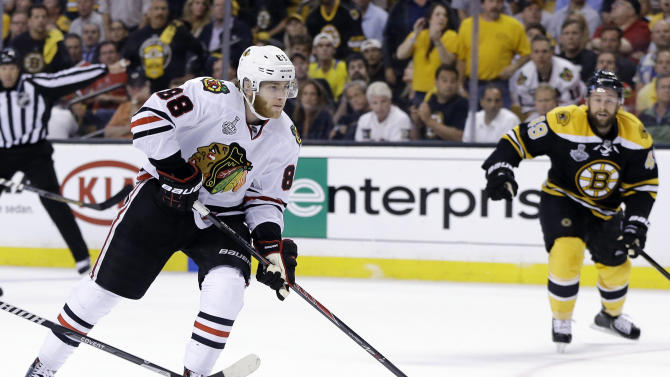 Chicago Blackhawks right wing Patrick Kane carries the puck against Boston Bruins center Rich Peverley, right, during the third period in Game 6 of the NHL hockey Stanley Cup Finals Monday, June 24, 2013, in Boston. Kane was presented the Conn Smythe Trophy, awarded to the team's most valuable player, and the Blackhawks beat the Bruins 3-2, to win the Stanley Cup. (AP Photo/Elise Amendola)