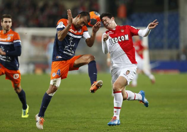 Montpellier's Hilton challenges Rodriguez of Monaco during their French League soccer match at the Mosson Stadium in Montpellier
