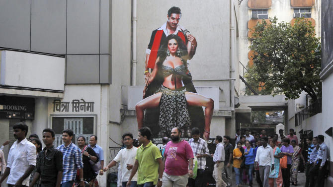 "In this April 25 2013 photo, Indians return after watching a Hindi movie in  Mumbai, India. Friday, May 3 marks exactly a hundred years after India's first feature film ""Raja Harischandra,"" a silent movie, was screened in 1913. India produced almost 1,500 movies last year and the industry is expected to grow from $ 2 billion to $ 3.6 billion in the next five years, according to consultancy KPMG. (AP Photo/Rajanish Kakade)"