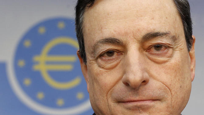 President of European Central Bank Mario Draghi waits for the beginning of a press conference following the meeting of the governing council in Frankfurt, Germany, Thursday, Feb. 6, 2014. The European Central Bank has left its benchmark interest rate unchanged, holding off on more stimulus despite weak economic growth and low inflation. The bank's 24-member governing council left the rate at 0.25 percent at a meeting in Frankfurt, Germany. Some analysts had thought the eurozone's monetary authority might cut the rate to 0.1 percent to try to boost growth more. (AP Photo/Michael Probst)