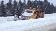 A snow plow on the side of the road on the Trans-Canada Highway near Little Rapids.