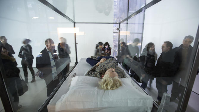 """Actress Tilda Swinton performs the art of sleeping in her one-person piece called """"The Maybe,"""" in New York's Museum of Modern Art,  Monday, March 25, 2013. In """"The Maybe,"""" first performed at the Serpentine Gallery in London in 1995, Swinton lies sleeping in a glass box for the day. The exhibit will move locations within the museum every time Swinton performs. (AP Photo/Richard Drew)"""