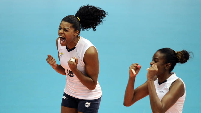Brazil´s players celebrate at the end of a women's volleyball semifinal match against Dominican Republic at the Pan American Games in Guadalajara, Mexico, Wednesday, Oct. 19, 2011. Brazil won 3-0. (AP Photo/Daniel Ochoa de Olza)