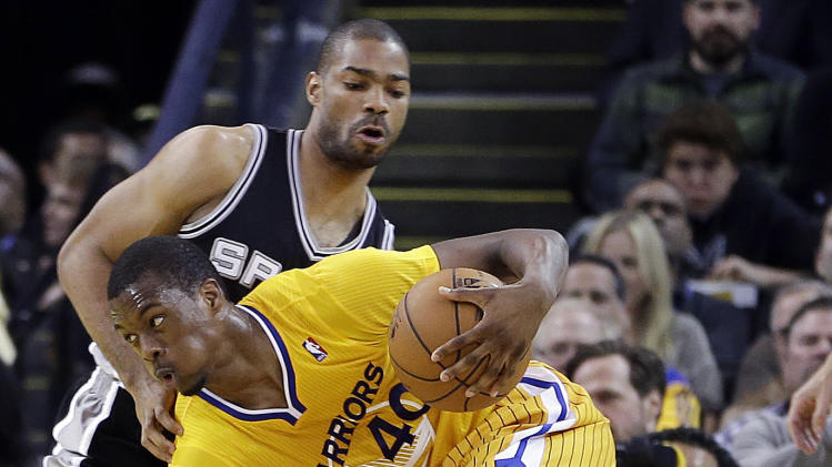 Golden State Warriors' Harrison Barnes (40) drives the ball past San Antonio Spurs' Gary Neal during the first half of an NBA basketball game Friday, Feb. 22, 2013, in Oakland, Calif. (AP Photo/Ben Margot)