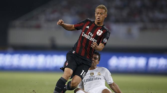 Honda of AC Milan fights for the ball with Casemiro of Real Madrid during the International Champions Cup soccer match in Shanghai