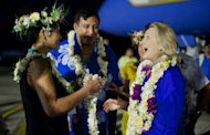 US Secretary of State Hillary Clinton (right) is greeted during an arrival ceremony in the Cook Islands on August 30. hina denied it was competing with Washington in the Pacific islands Thursday, as Clinton arrived at a regional summit aiming to reassert US influence