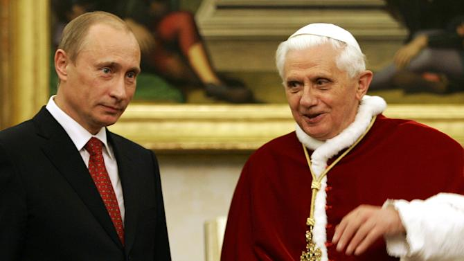 FILE - In this Tuesday, March 13, 2007 file photo, Pope Benedict XVI talks with Russia's President Vladimir Putin, left, during their meeting at the Vatican. Benedict announced Monday Feb. 11, 2013, he will resign Feb. 28 _ becoming the first pontiff to step down in 600 years. His decision sets the stage for a mid-March conclave to elect a new leader for a Roman Catholic Church in deep turmoil.  (AP Photo/Andrew Medichini, File)