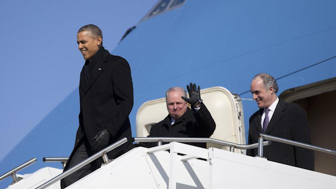 President Barack Obama, followed by Rep. Michael Doyal, D-Pa., center, and Sen. Bob Casey, D-Pa., right, arrive at the 171st Air Refueling Wing Pennsylvania Air National Guard on Air Force One, Wednesday, Jan. 29, 2014, in Coraopolis, Pa., as he travels to speak at the U.S. Steel Irvin Plant, in West Mifflin, Pa., to speaks about retirement policies he highlighted in the State of the Union Address. (AP Photo/Carolyn Kaster)
