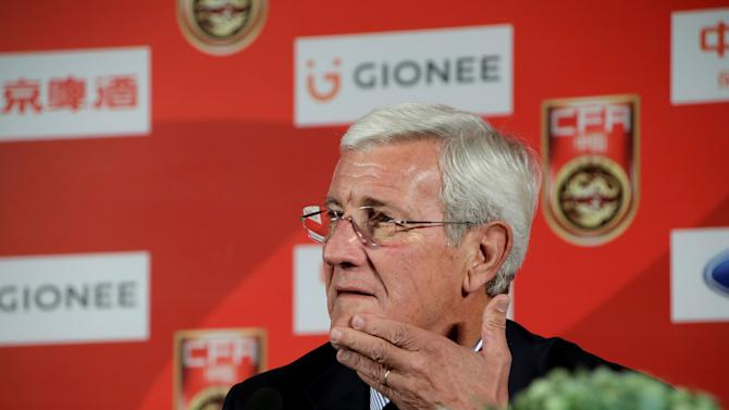 Marcello Lippi attends a news conference in Beijing